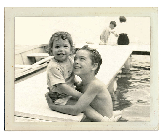 Two children sitting on a boat.